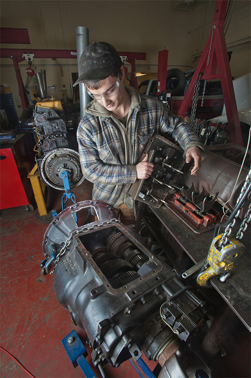 CTC student inspects transmission as part of a diesel mechanics course