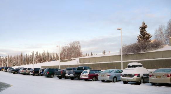 Cars outside of the Butrovich building during a snowy morning.