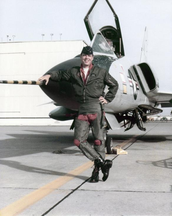 Gamble poses with his plane during his early days as a fighter pilot.
