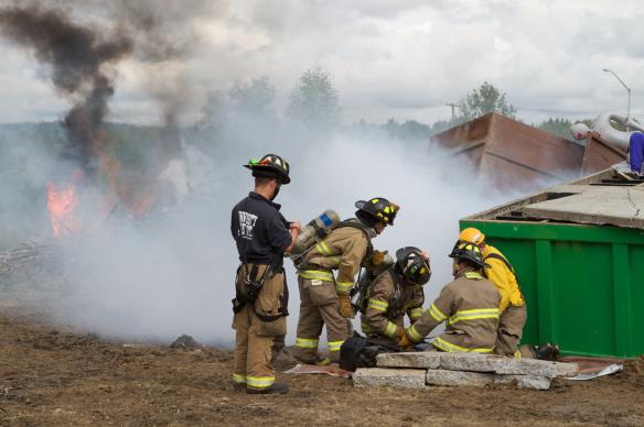 Members of the UAF Fire Department practice emergency rescue during a full-scale exercise in July 2011.