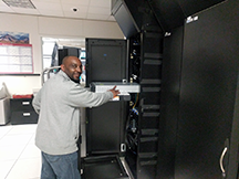 Ambrose Mazion demonstrates the ease of the ServerLIFT at the UA Data Center