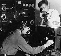 Stuart Seaton with telephone and one of the radio operators at the Ballaine Lake Receiving Station. Photo: Geophysical Institute
