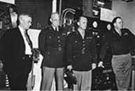 Army Chief of Staff General Dwight D. Eisenhower tours the University of Alaska campus. From left are President Bunnell, General Dwight D. Eisenhower and staff. Photo: UAF Rasmuson Library