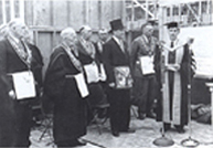 Geophysical Institute's cornerstone ceremony, July 1, 1949. From left, Frank Mapleton, Charles Bunnell, C.J. Woofter, Lou Joy, James Jorgensen, Les Nerland and Seaton.