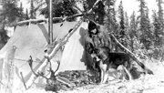 Margaret Murie and dog by camp tent. Photo: Murie Collection