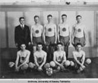 Standing from left to right: Abel (coach), Reed, T. Loftus, A. Loftus, G. Lingo. Sitting: R. Boyd, R. Anderson, D. MacDonald and J. Boswell. Photo: UAF Rasmuson Library