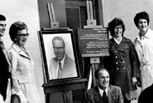 At the 1975 building dedication, O'Neill's family poses with his photograph. Pictured are his son, William; widow, Vi; brother Patrick; and daughters Sally Wien and Maureen O'Neill.