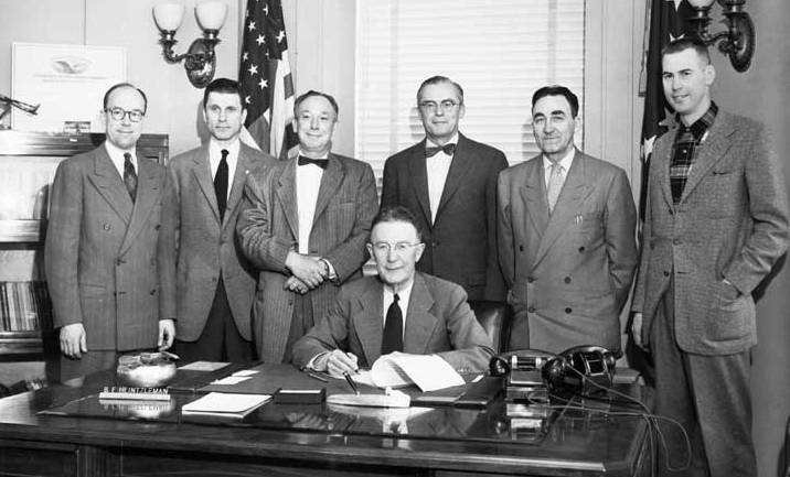 March 21, 1955. Governor B. Heintzleman signing bill authorizing a statehood convention to be held November 8, 1955 at the University of Alaska. Right to left: Repr. Tom Stewart, Juneau; Senator John Butrovich, Fairbanks; Senator Earl Cooper, Anchorage; House Speaker, Wendell Kay, Anchorage; Senate President, James Nolan, Wrangell; House Minority leader, Joseph McLean, Juneau. Photo by Joseph W. Alexander